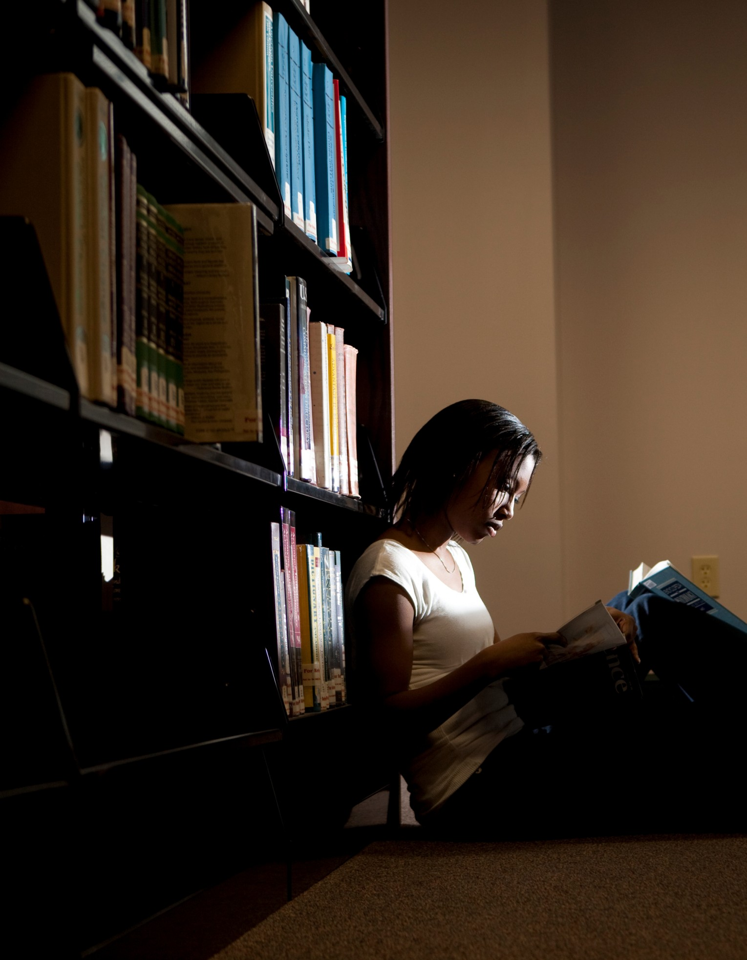 student in library at midway university
