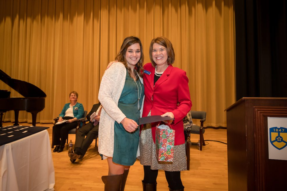 Kaci Leatherwood (L) receives Outstanding Freshman Award from Midway Nursing Faculty Member Keely Lowe (R)