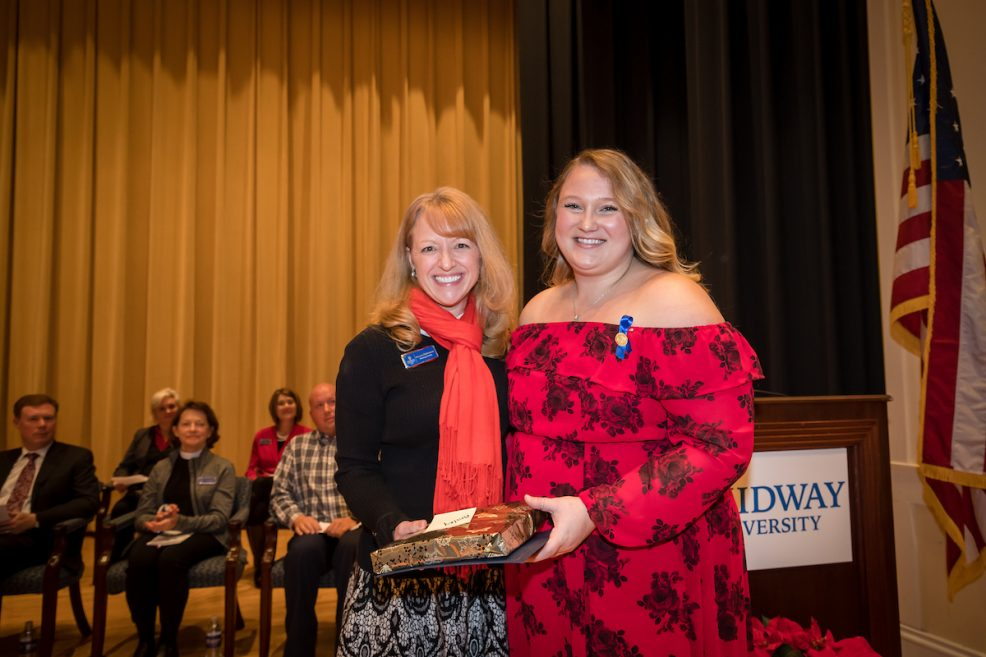 Midway Nursing Faculty member Shannon Muhlenkamp (L) presents Clinical Award to Ansley Yankey (R)