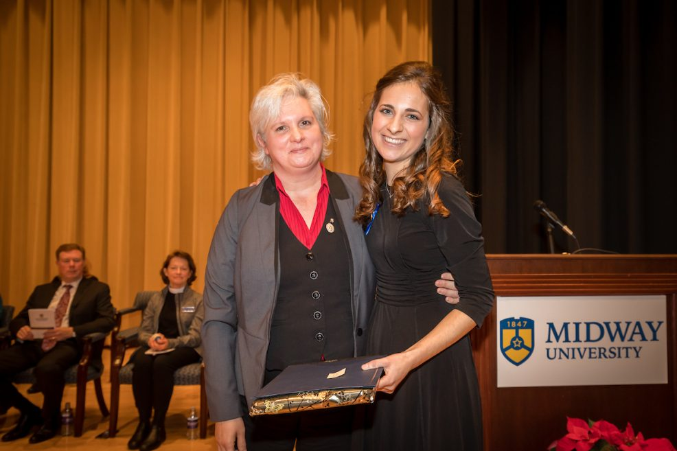 Midway Nursing Faculty member Tonya Stephens (L) presents Florence Nightingale Award to Stacy Frost (R)