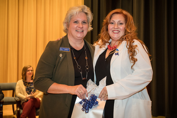Tonya Stephens (left) recognized Christina Smith (right) for her service to Midway Association of Nursing Students (MANS).